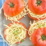 Tomatoes stuffed with a mixture of spaghetti, fresh herbs and cheese