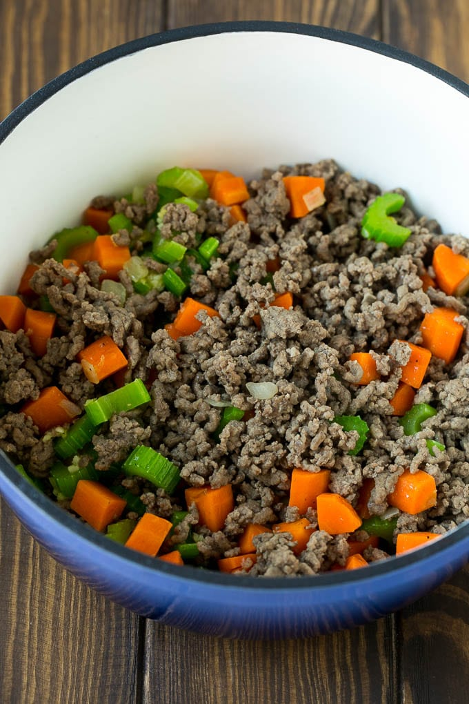 Ground beef, carrots, onion and celery in a soup pot.