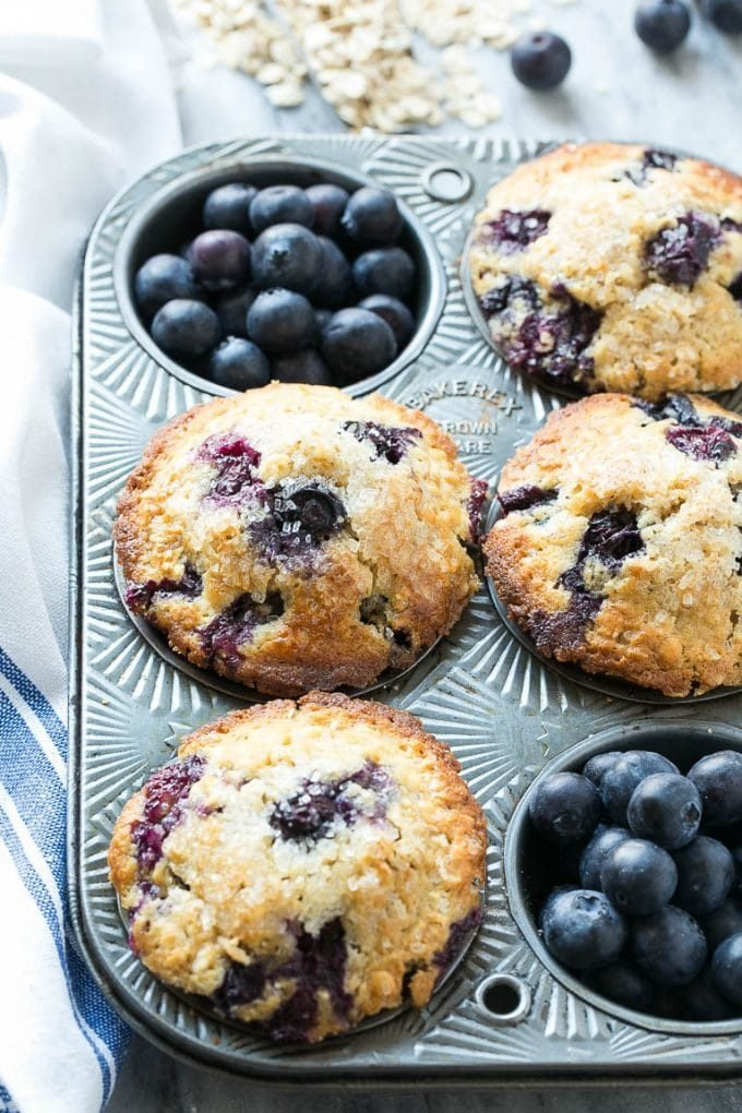 A muffin tin filled with blueberry muffins.