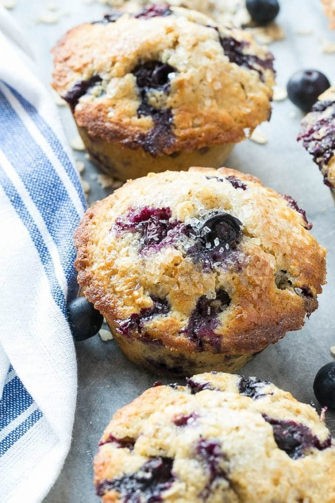 Oatmeal blueberry muffins on a marble slab.