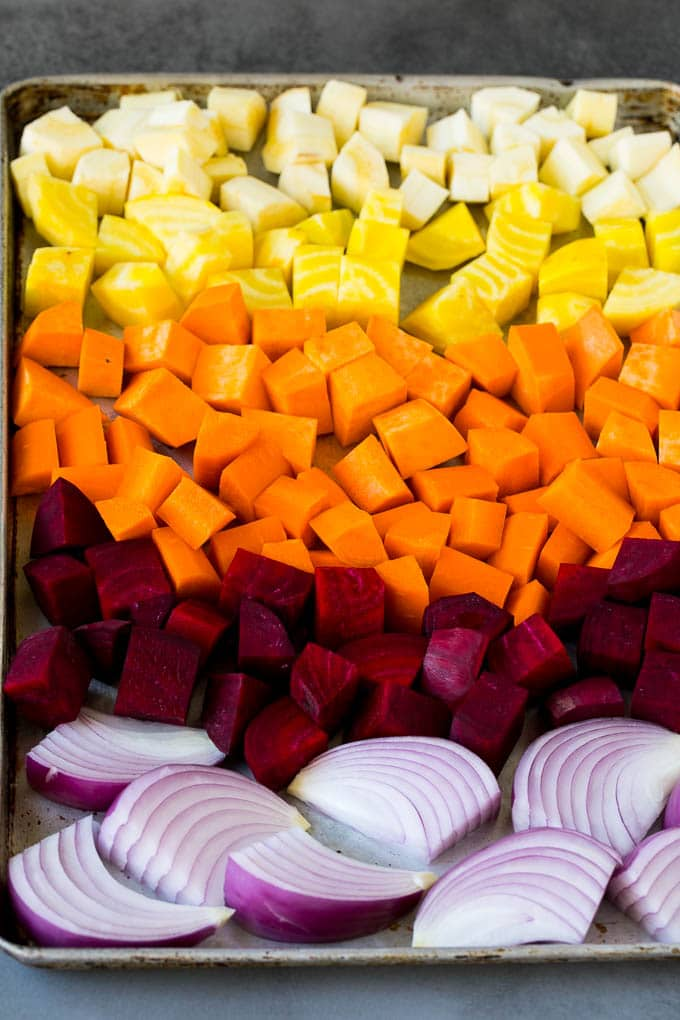 Onions, carrots, beets, parsnips and sweet potatoes on a sheet pan.