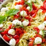 Caprese pasta with fresh diced tomatoes, mozzarella balls and thinly sliced basil.