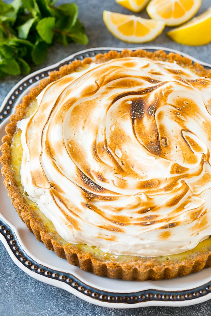 A lemon meringue tart topped with toasted brown sugar meringue.