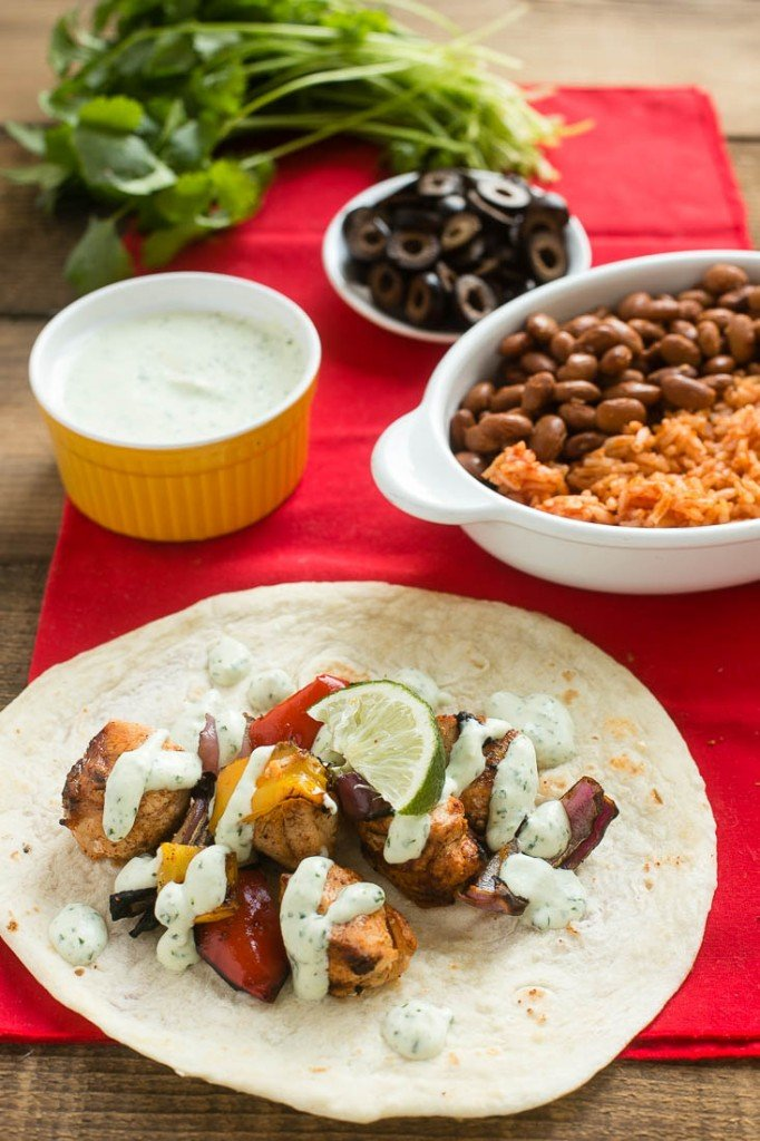 These chicken fajitas on a stick with creamy cilantro dipping sauce make a great appetizer or main course.