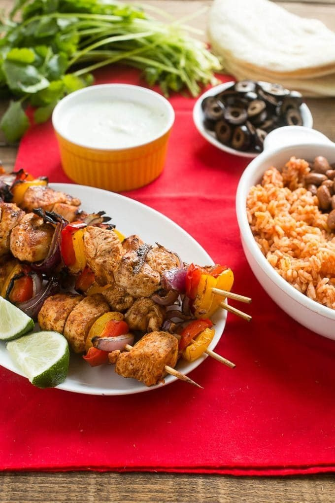 Grilled chicken fajitas served with rice, beans and cilantro lime sauce.