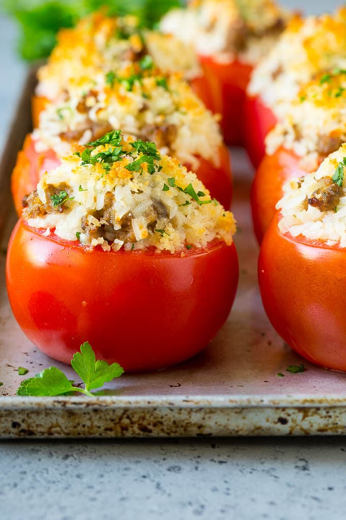 Stuffed tomatoes filled with rice, Italian sausage and cheese.