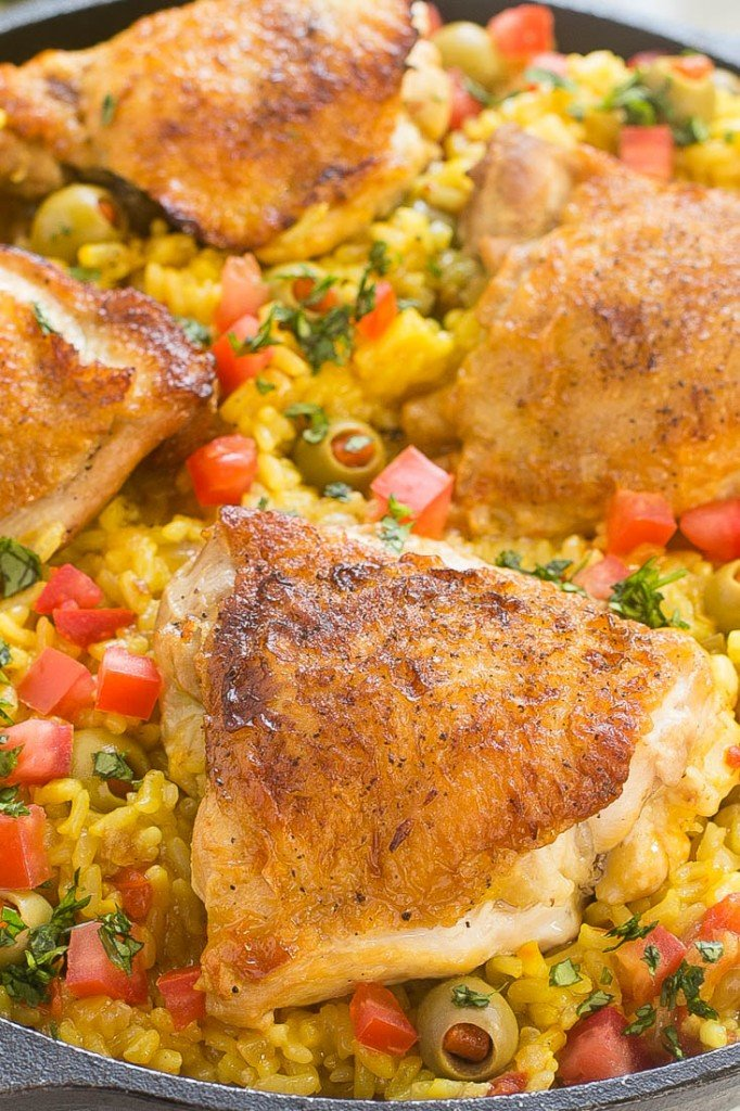 This recipe for Spanish Arroz con Pollo is a one pot meal that's full of tender chicken thighs, creamy saffron rice and olives - the perfect quick and easy dinner!