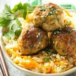 This recipe for asian turkey meatballs involves light and tender meatballs that are seasoned with asian flavors, tossed in a honey garlic sauce and served over a colorful carrot rice. It's a quick and easy weeknight meal that the whole family will love!