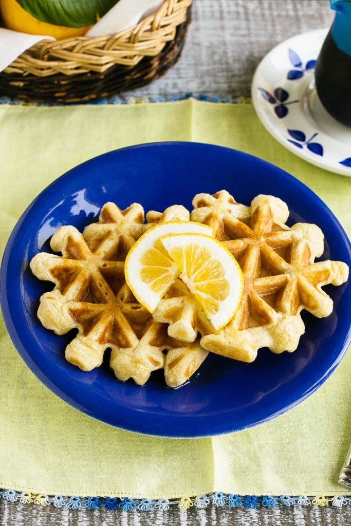This recipe for lemon waffles made with sour cream are light and fluffy with the perfect amount of tang. Serve these waffles with maple syrup or lemon curd for the perfect weekend breakfast!