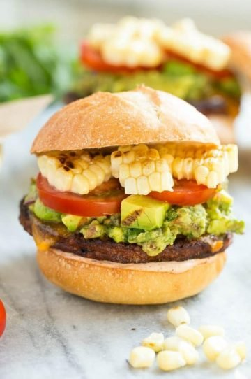 This recipe is for a black bean veggie burger with a Mexican twist! The veggie patty is layered with southwestern sauce, grilled corn, guacamole, cheese and tomatoes to create a hearty vegetarian sandwich.