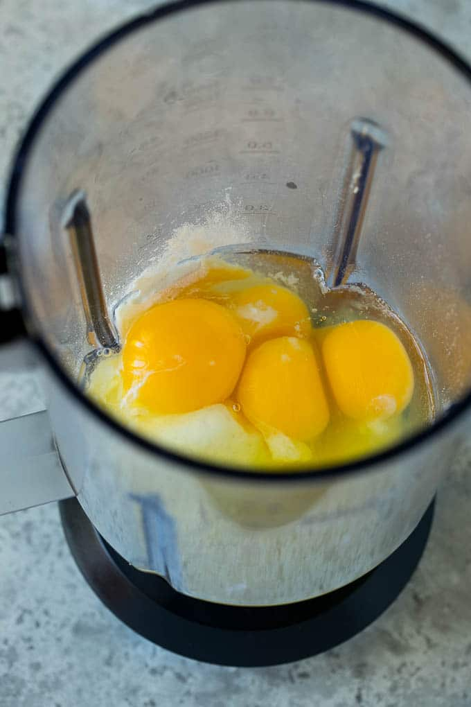 Eggs, milk, sugar and flour in a blender.