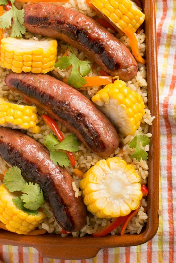 This sausage and rice bake is full of summer vegetables and is a complete meal in one pot!