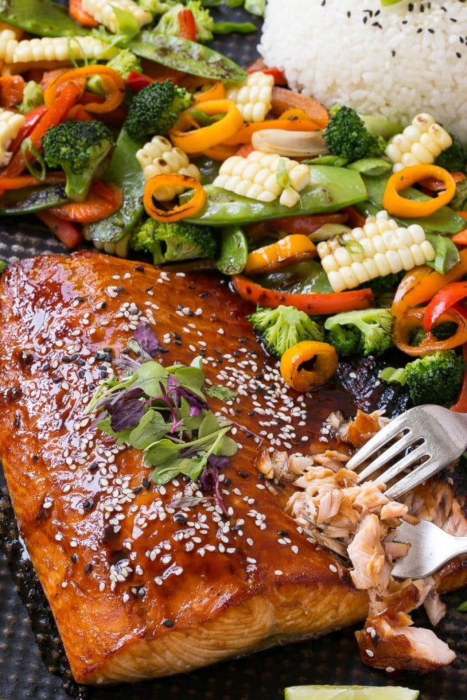 Asian salmon on a sheet pan with vegetables and rice.
