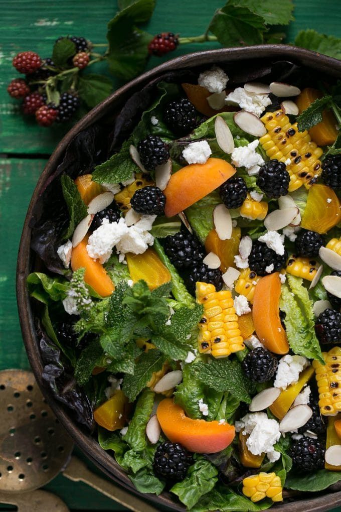 Blackberry salad with apricots, corn, feta cheese and almonds.