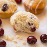 Light and tender muffins, studded with fresh cherries and topped with a sweet vanilla glaze.