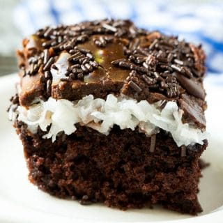 This chocolate coconut cake recipe is a rich chocolate cake topped with a creamy coconut marshmallow sauce and finished off with a layer of chocolate frosting.