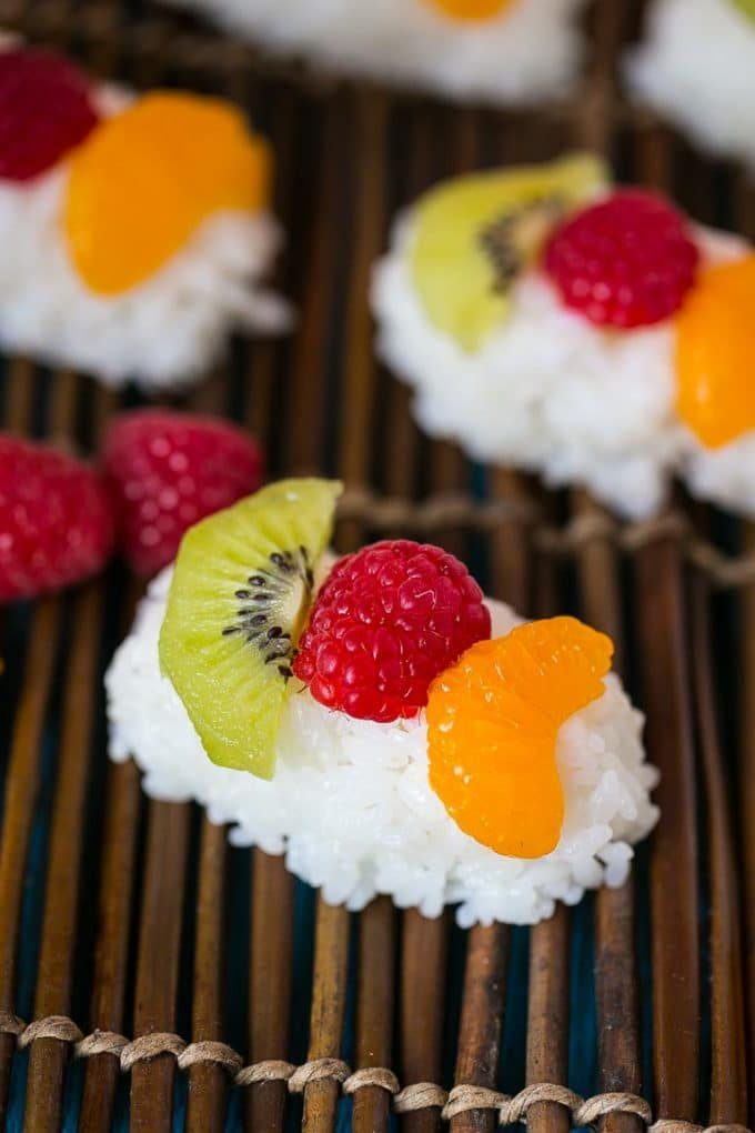 Sweet coconut rice topped with fresh fruit for frushi.