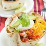 This recipe for healthy chicken taco salad is marinated and grilled chicken with shredded lettuce, creamy cilantro dressing and your favorite taco toppings, all inside a baked tortilla shell.