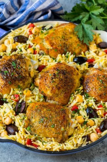 A pan of Mediterranean chicken with orzo, chickpeas and vegetables.