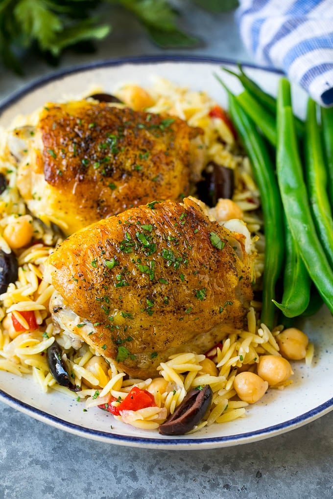Mediterranean chicken thighs served over orzo with green beans.