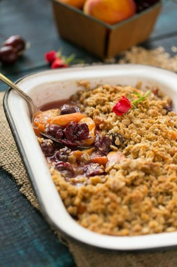 The ultimate fruit crisp featuring your favorite summer fruit and a buttery oatmeal walnut topping.
