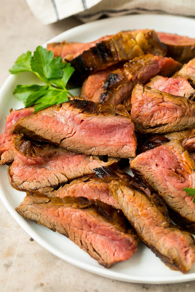 Flank steak marinade flavored meat that's been thinly sliced.