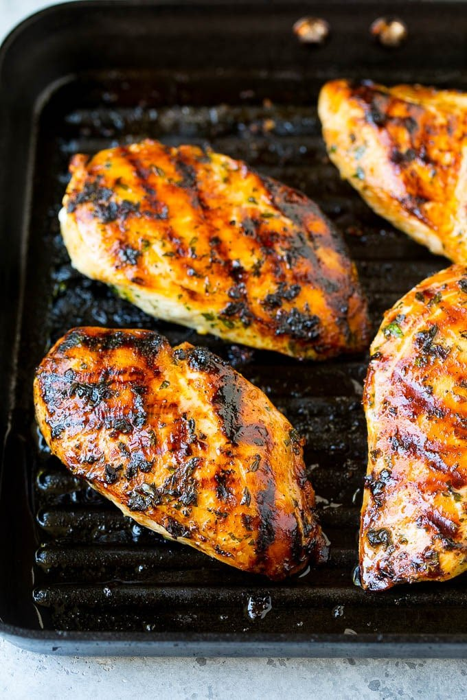 Chicken breasts cooked on a grill pan.
