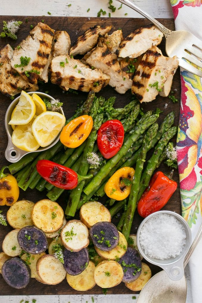 One Dish Grilled Chicken Dinner - the lemon herb chicken, potatoes and vegetables all cook on the grill , super easy and only a single dish to clean at the end!