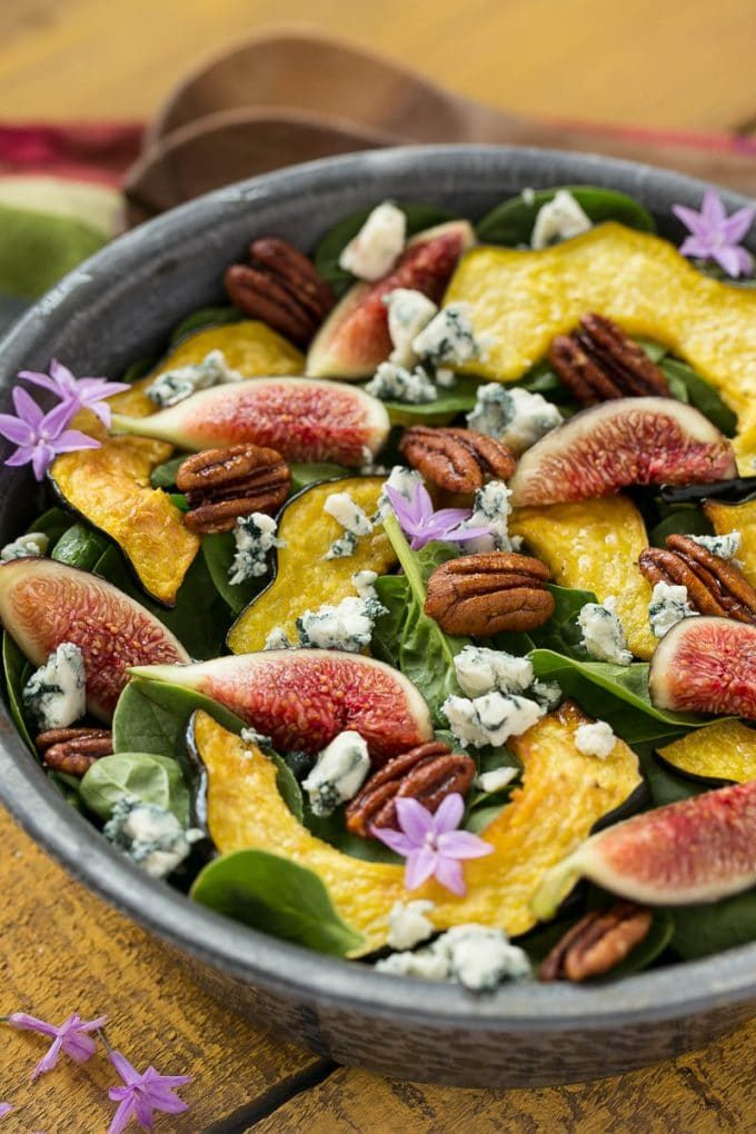 Fig salad with spinach, acorn squash, pecans and blue cheese.