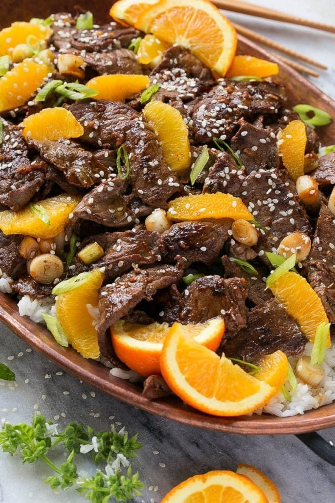Orange beef topped with green onions and sesame seeds.