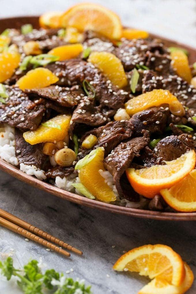 A platter of beef in orange sauce.