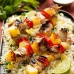 A recipe for sweet and spicy pineapple pork kebabs served on a bed of pineapple cilantro rice. #KingofFlavor AD @ElYucateco