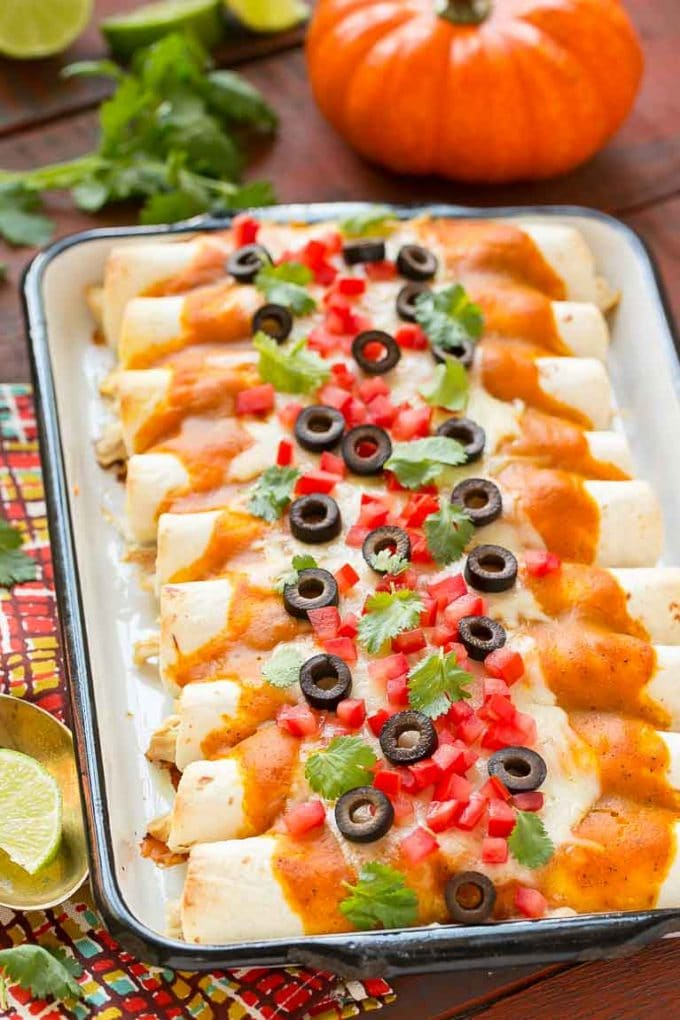 Pumpkin isn't just for dessert! These chicken enchiladas are made with a velvety pumpkin sauce that's totally savory and an unexpected way to elevate enchiladas into a dish fit for company. #ChooseSmart Ad