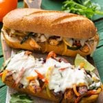 These fajita chicken cheesesteak sandwiches are full of spiced chicken, peppers and lots of cheese, all on a toasted roll. AD