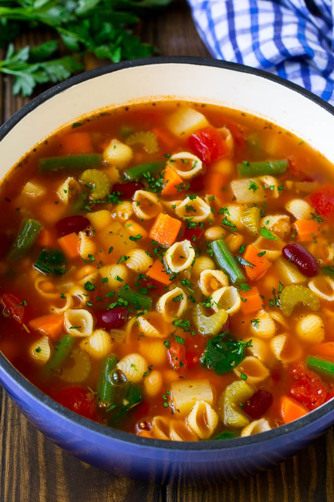 A pot of minestrone soup with vegetables, beans and pasta.