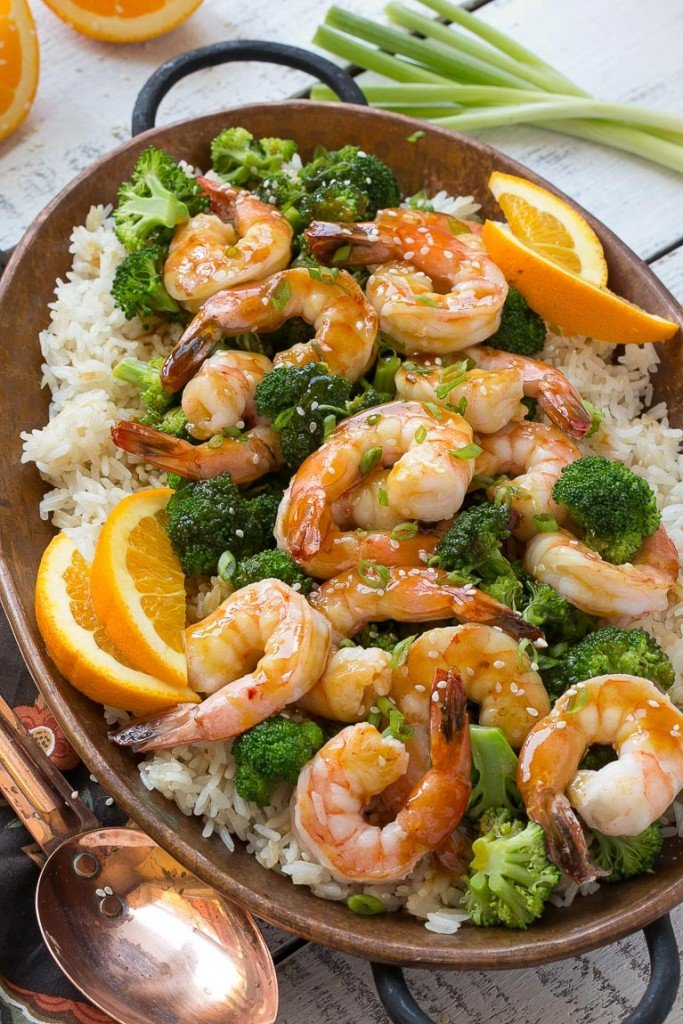 This orange shrimp and broccoli with garlic sesame fried rice is the perfect quick and easy meal for a busy weeknight or for entertaining guests. #HolidayRiceRecipes Ad