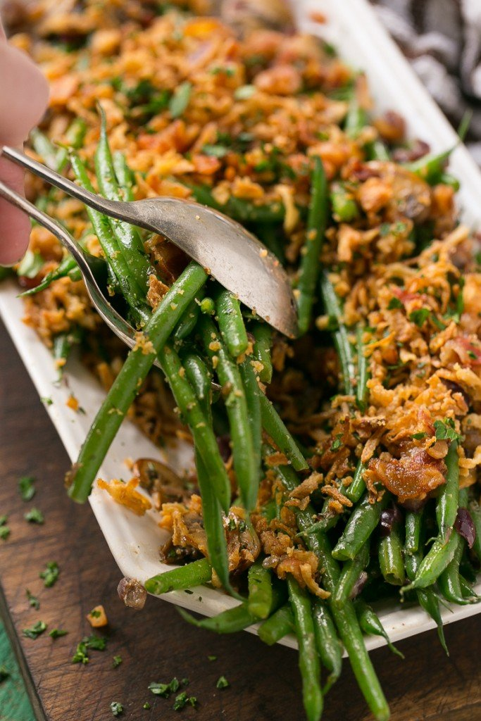 These green beans are cooked in a ranch butter sauce and topped with crispy onions and bacon. SO much better than green bean casserole!