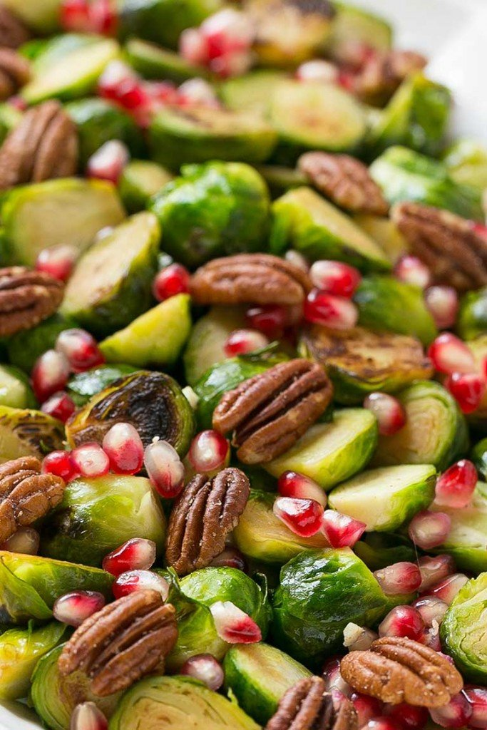 These pomegranate pecan brussels sprouts are a healthy and colorful side dish with just 5 ingredients and 5 minutes of prep time.