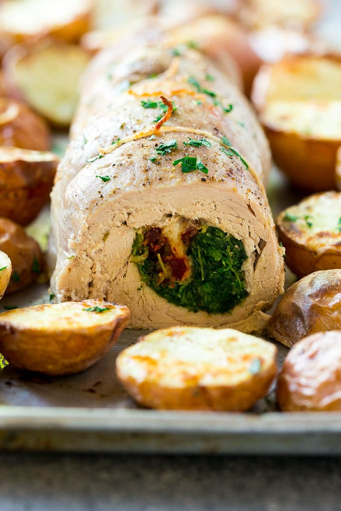 A sliced stuffed pork tenderloin filled with spinach and cheese.