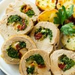 Slices of stuffed pork tenderloin filled with sun dried tomatoes, cheese and spinach.