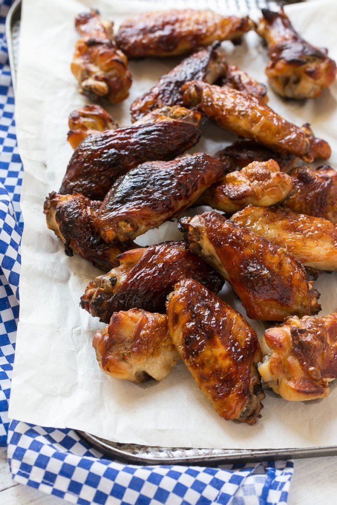 These sweet and tangy baked chicken wings are smothered in a homemade barbecue sauce. They're extra crispy without any frying required!#OneOfAKindFan #ad