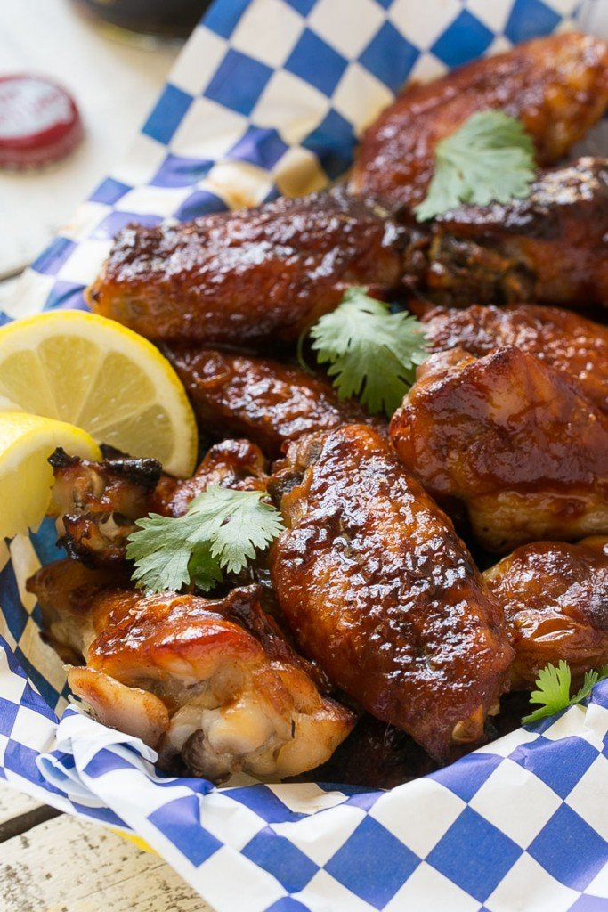 These sweet and tangy baked chicken wings are smothered in a homemade barbecue sauce. They're extra crispy without any frying required! #OneOfAKindFan #ad