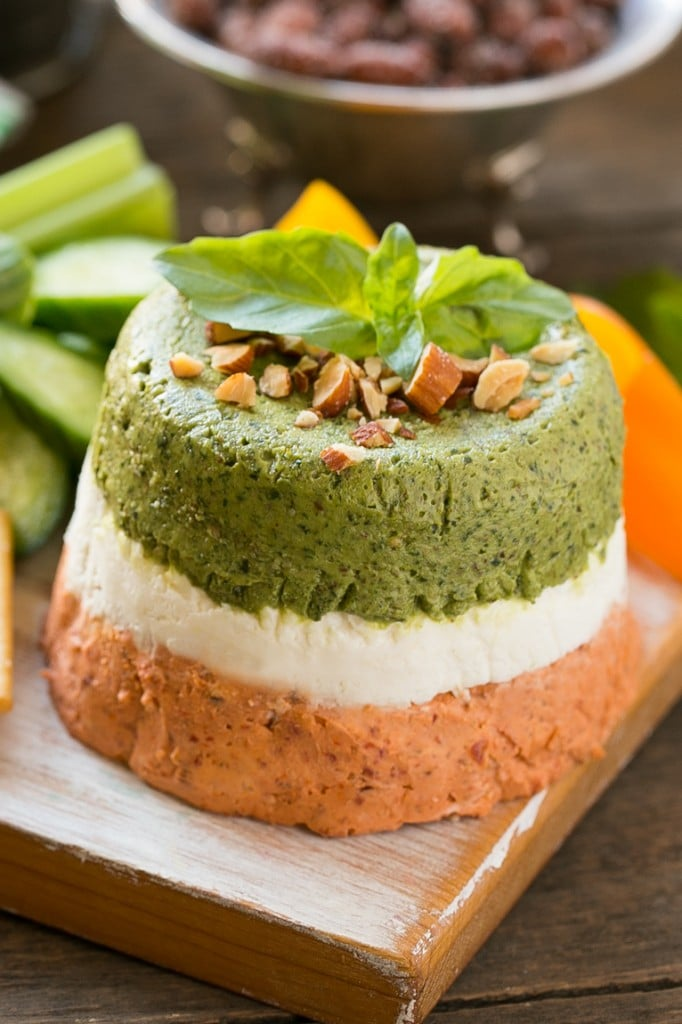 This layered almond pesto dip is an easy yet impressive appetizer that comes together in minutes with the help of a food processor. #ad