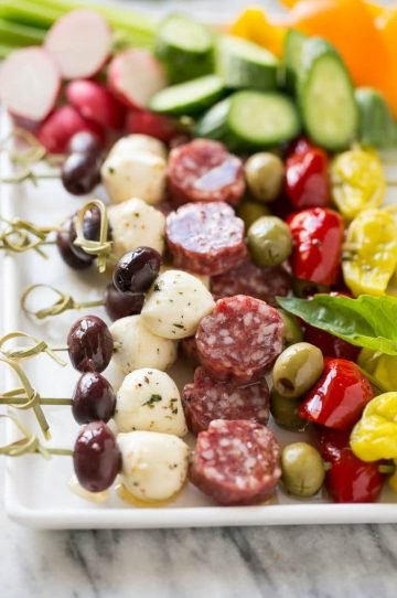 These antipasto skewers are an assortment of italian meats, cheeses, olives and vegetables threaded onto a stick for a super easy yet elegant appetizer.