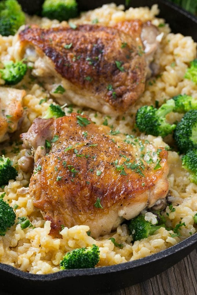 Chicken thighs served over cheesy broccoli rice.