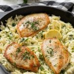 This one pot chicken with creamy spinach artichoke pasta is made with seared chicken breasts, orzo pasta, fresh spinach, artichokes and plenty of cheese. It's a quick and easy weeknight dinner with less dishes to do at the end!
