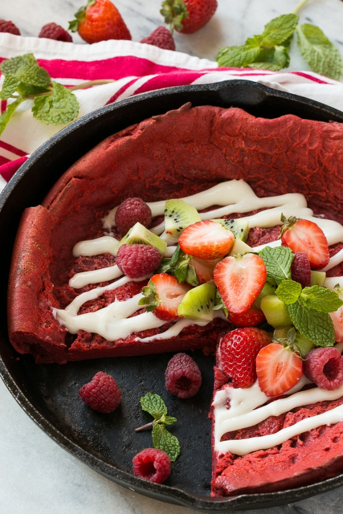This giant red velvet puffed pancake bakes up in the oven and is topped with a cream cheese glaze and fresh fruit. It's a breakfast delight that will brighten up any morning!