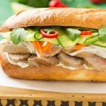 This recipe for a bahn mi sandwich starts with a crusty french roll that's then piled high with tender slices of pork, pickled vegetables and fresh herbs for a hearty meal that's full of flavors, colors and textures!