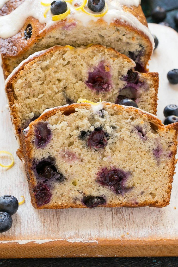 This recipe for blueberry banana bread is a moist loaf of the classic sweet bread that's chock full of juicy blueberries and topped with a lemon cream cheese glaze.