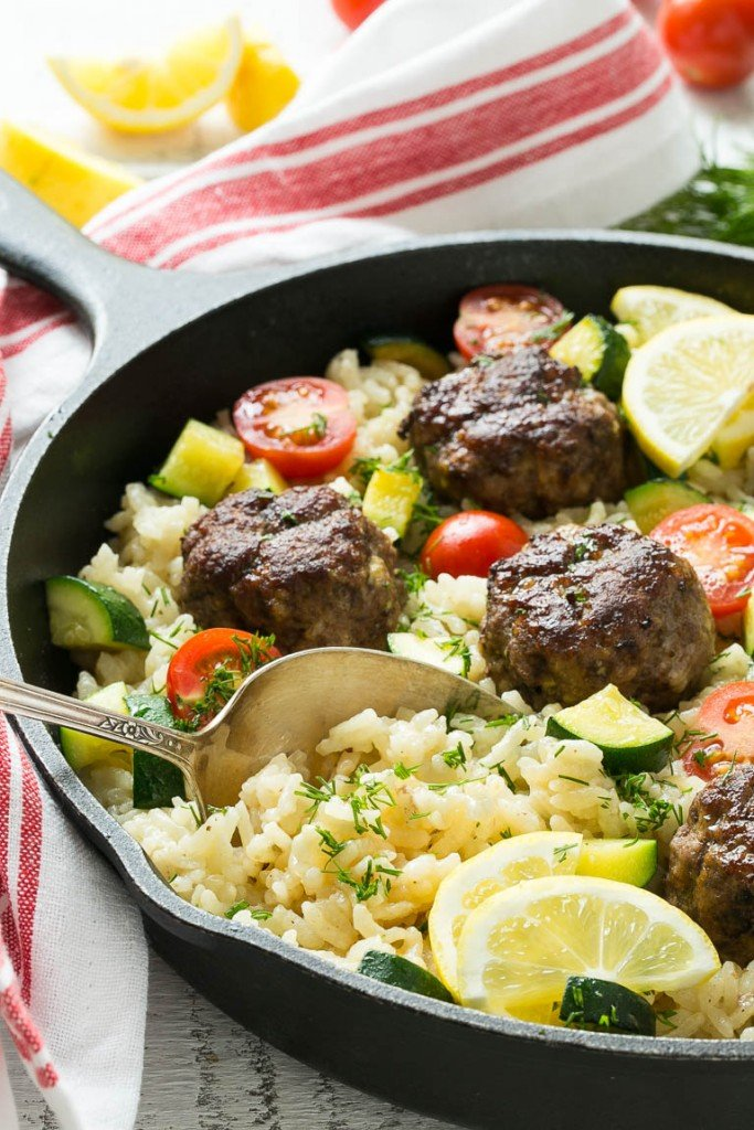 This recipe for one pot greek meatballs with lemon dill rice includes savory greek spiced beef meatballs, creamy arborio rice and vegetables, all cooked together in a single pot! #VillageHarvestInspired